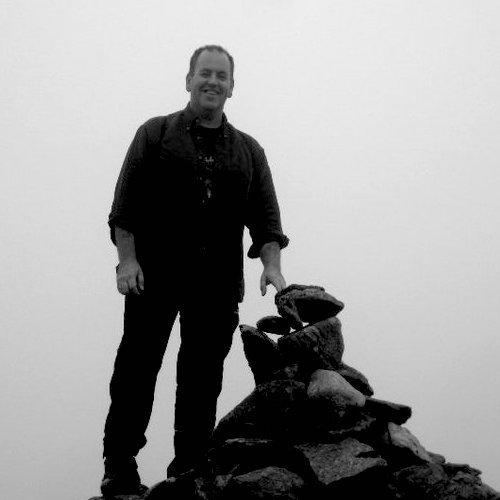 Artist Ade Hughes on a mountain top